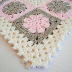 A gorgeous, handmade, keepsake baby afghan would make a perfect baby shower gift or an heirloom to be passed down through the family. It would also be a fantastic photo prop too! Generously sized for crib use, it's ideal for the newborn infant baby, toddler or young child or it could even be used as a throw blanket, a lapghan, a lap robe or for wheelchair use. The design is written in standard U.S. terminology and based on a crochet flower square and the typical granny stitch pattern. The…