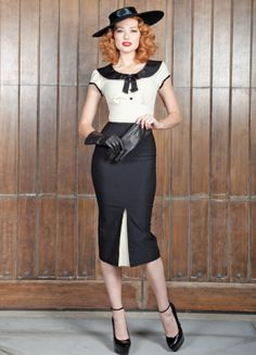 This is a must have look for the fall!! Reminiscent of 1930's Parisian style, the dress has an elegant and classy feel. All eyes will be on you as you gracefully move from the office to cocktails later at night