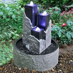 Stone effect water feature with three towers. Ideal for a patio or small garden.