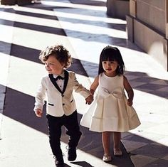 The most adorable flower girl and ring bearer we've ever seen! Walking hand in hand, aren't they the cutest? Tag your loved ones right away!  Photo via @thewedlist