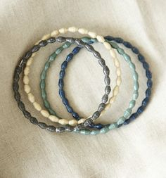 31 Bits jewelry empowers women in Uganda to rise above poverty. Check out what they do and pick up some cute summer accessories! (Blue Breeze Bangles)
