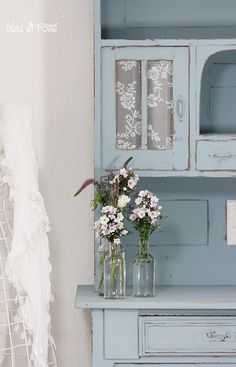 F u r n i t u r e idea for bedroom or bathroom.  Glass door cupboard with lace inserts