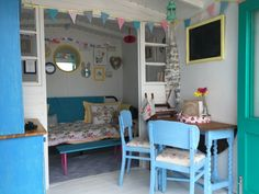 With coral front doors and sea green base, you'll find this stunning Beach Hut for Hire on the front row on Southcliff Promenade, Walton on the Naze, Essex Beach Shack, Beach Huts, Coral Front Doors, Beach Hut Interior, Beach Hut Decor, Allotment Shed, Walton On The Naze, Shed Makeover, Shabby Chic Garden