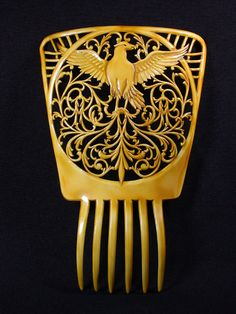 Large mantilla style hair comb in celluloid with eagle motif.