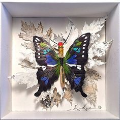 """""""Purple Spotted Swallowtail"""" - Butterfly Assemblage in a Shadowbox. A butterfly assemblage created with rag paper, acrylic paint, a small paintbrush, and wire. The butterfly is a species found in nature and is enclosed in a shadowbox."""
