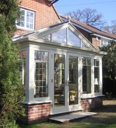 Gable-ended conservatory with pilasters and 'T' bar fenestration