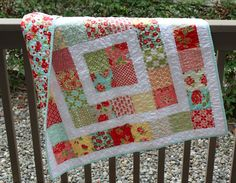"A Quilter's Table:  Storytime Squares baby quilt made with 5"" charm squares to finish @ 42"" square.  She quilted with her machine's wavy stitch stretched as far as it would go.  I love this quilt, the pattern, the fabrics, and the quilting."