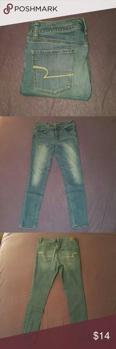 American eagle jeans These are high waisted, medium wash American Eagle brand skinny jeans. GOOD CONDITION. Size 8. American Eagle Outfitters Jeans Skinny