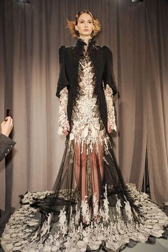 NYFW Marchesa Fall 2011 It was elegant gown after elegant gown all worthy of the most prestigious red carpet event or a royal ball. The gowns were regal to say the least. Victorian style a major influence