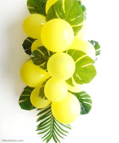 DIY Balloon and Fronds Tropical Party Table Centerpiece Garland - learn to make this easy table decor for your birthday table, party photo booths or summer party decorations!