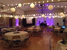 LDS Cultural Hall Wedding Reception decorated with 400+ Bulb Lights, 50 White Paper Lanterns to create a Drop Ceiling.