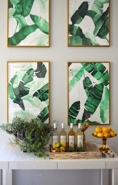 Set of banana leaf prints by The Aestate in brassy frames