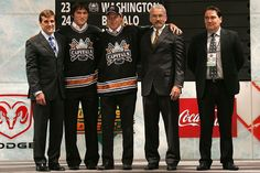 Alexander Ovechkin (2nd from L) of the Washington Capitals poses with 4th overall pick Nicklas Backstrom (C) of the Capitals and team personnel on stage during the 2006 NHL Draft held at General Motors Place on June 24, 2006 in Vancouver, Canada. (Photo by Bruce Bennett/Getty Images)