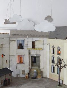 I find this (um, what to call it, I want to call it a puppet set) to be so delightful. I suspect the clouds on wires appeal first and foremost, but all the little details of the structures are sweet and well executed.