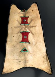 Africa | Shield or Arar from the Hoggar region in southern Algeria  | Onyx antelope skin, black pigment, iron, copper, red cloth and dyed leather