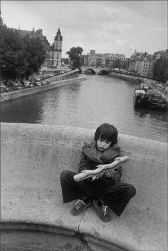 'L'enfant à la baguette épi - Pont Neuf, Paris' by René Burri, 1975
