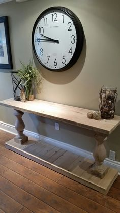 Reclaimed wood console table cut from barn beams