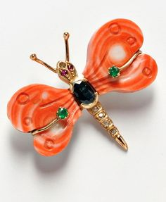 Coral Brooches, two 18kt gold and coral rose brooches and a 14kt gold butterfly, 19.4 dwt.