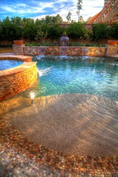 Beautiful beach entry pool with spa and water features
