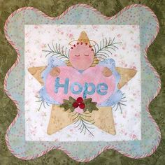 "'Tis the Season: Angel block in ""Anita's Christmas Quilt"" by Pearl Pereira. This quilt features 6 angels with messages of hope, faith, charity, love, joy and peace."