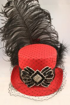 Burlesque Mini red w\/ black top hat with veil.
