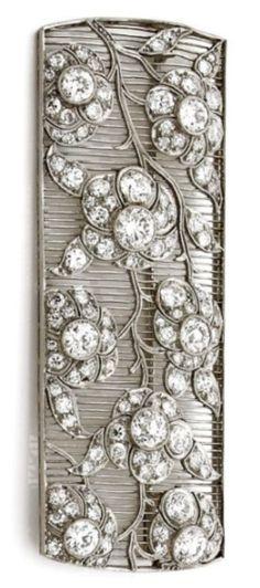 An Art Deco diamond and platinum brooch, circa 1930. The rectangular openwork brooch with floral motifs set with diamonds, mounted in platinum. #ArtDeco #brooch