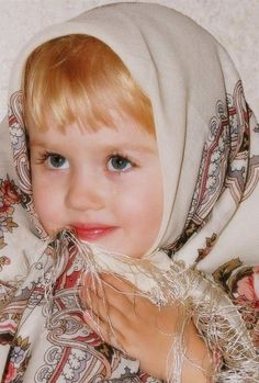 A Russian girl is dressed in the national Pavlovsky Posad shawl.