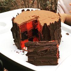 Lumberjack themed smash cake with buffalo plaid inside!