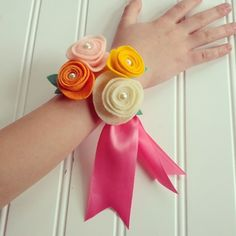 Transform simple felt + pearl rosettes into a precious little girl's wrist corsage for Easter or a special party.  Tutorial at handcraftedparties.com  {photo via Instagram @lisafrankparties}