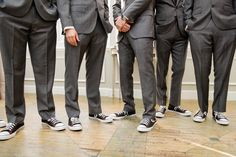 Personalised Converse black and orange sneakers made for every one of the groomsmen