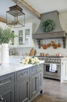 Farmhouse Kitchen with Fall Decor-Center Island Design-Lantern Pendant Lights-White Kitchen-Glass Kitchen Cabinets-Copper Pots-Dark Center Island-Restoration Hardware Paint #kitchencabinetsdiy
