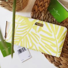 "Kate Spade Grainy Vinyl Yellow Palm Tree Wallet ✨NWT. Original price $135!✨  100% Authentic gorgeous Kate Spade Grant Street Gainly Vinyl yellow palm tree wallet. Custom woven lining, zip around continental wallet, 12-karat light gold plated hardware, 12 credit card slots - 2 billfolds.  Measurements: 4""H x 7.5""L x 0.8"" W  ❗️Fair offers welcome, no trades.  Non smoking home.  Same/next day shipping.  Enjoy  kate spade Bags Wallets"