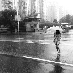 Woman in the deluge #rain #shanghai #china