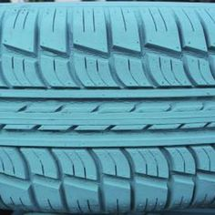 A non-toxic outdoor paint is typically recommended for painting tires. More