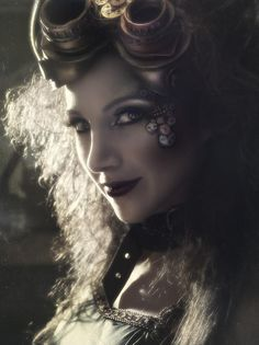 I love the gear make-up on her face, and how the light shines through her hair. She's kickass and yet ethereal too.