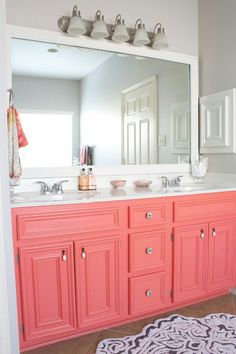Would be great for a girl's bathroom. This is really pretty. The gray walls, framed mirror, coral cabinets. Sherwin Williams - coral design and decoration de casas interior design ideas House Design, House, Interior, White Counters, Girls Bathroom, Sweet Home, Bathroom Decor, Coral Bathroom, Bathroom Inspiration