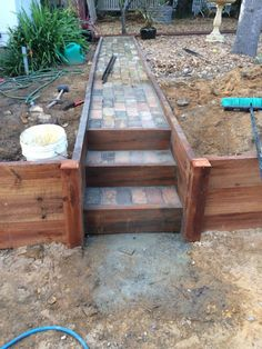 DIY timber retaining wall with brick path DIY timber retaining wall with brick path Brick Driveway, Brick Path, Backyard Projects, Outdoor Projects, Wood Retaining Wall, Outdoor Steps, Garden Stairs, Front Yard Landscaping, Landscaping Ideas