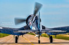 Cavanaugh museum FG-1D Corsair with Chuck Gardner at the controls taxis out at Oshkosh 2015