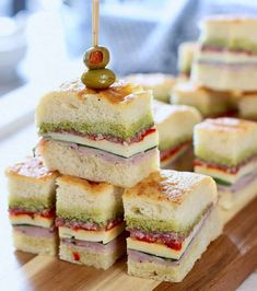 These Italian Pressed Sandwiches are stuffed with salami, ham, cheese and roasted red peppers. Pressed overnight and served as appetizers or lunch! Mini Sandwiches, Italian Sandwiches, Bridal Shower Sandwiches, Sandwiches For Parties, Roast Beef Tea Sandwiches, Mini Sandwich Appetizers, Party Finger Sandwiches, Sandwich Bar, Tea Party Sandwiches Recipes