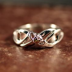 Claddagh Infinity Ring. Inside it's inscribed with the words, anam cara, which means soul mate.
