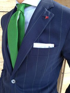 A kelly green tie adds the perfect pop of color to this navy pinstripe suit & light blue dress shirt. A simple white pocket square completes this stylish look! Navy Pinstripe Suit, Navy Suits, Suit And Tie, Well Dressed Men, Dress For Success, Dapper, Dress To Impress, Men Dress, Dress Shirt