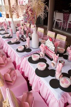 Pink and black table at a Minnie Mouse birthday party! See more party ideas at CatchMyParty.com!