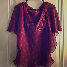 """Seeing Dots Super adorable Boutique top in burgundy with tan dots. Body of top is fully lined. Sleeves are 3/4 length and flowing. Low V neck so may want to wear a Cami or a low plunge bra when wearing. Jonathan Martin, Size Medium, Shell & Lining both 100% Polyester, 25"""" length, 17"""" across bust. You'll be glad you added this lovely to your collection. Jonathan Martin  Tops Tunics"""