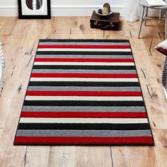 Viva Rugs feature a trendy red, black and ivory striped design. The heavyweight Frisee pile is super soft, stain resistant, colourfast, anti shed and water repellent. Coffee Shop Design, Striped Rug, Southwestern Style, Rugs On Carpet, Carpets, Red Rugs, Stripes Design, Modern Rugs, Traditional Design