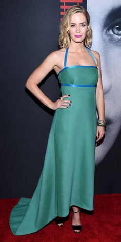Emily Blunt was radiant at the New York City premiere of Girl on the Train in a custom jade green Prada gown trimmed with blue satin. She completed her look with a Prada clutch, Lorraine Schwartz jewelry, and black Louboutin sandals.