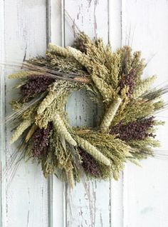 Tapestry Bird Door Wreath. A rich tapestry of naturally grown Black Bearded Wheat, Spray Millet, Canary Grass and Red Sorghum make this a wreath to enjoy inside or outside, as a bird feeder.. Price: $57.95