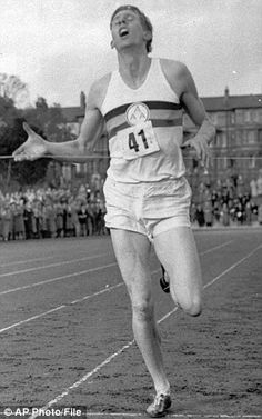 OXFORD, 1954: Roger Bannister crosses the finish line, running a mile in 3:59.4, in thin leather slippers.