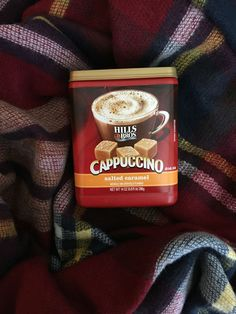 A cozy blanket and some delicious cappuccino make the perfect date.