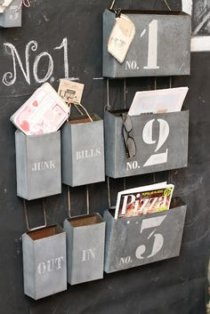 Create your own file folder hangers out of old mailboxes, paint, and lettering