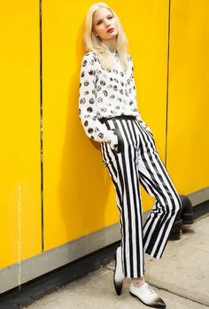 Anna is rockin black and white like a boss with a funky top, vertical striped pants and black dipped white oxfords   Anna Piirainen by Matallana for Blank Magazine